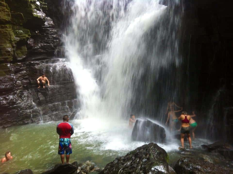 Visit of a sacred waterfall during Ayahuasca retreat in Ecuador